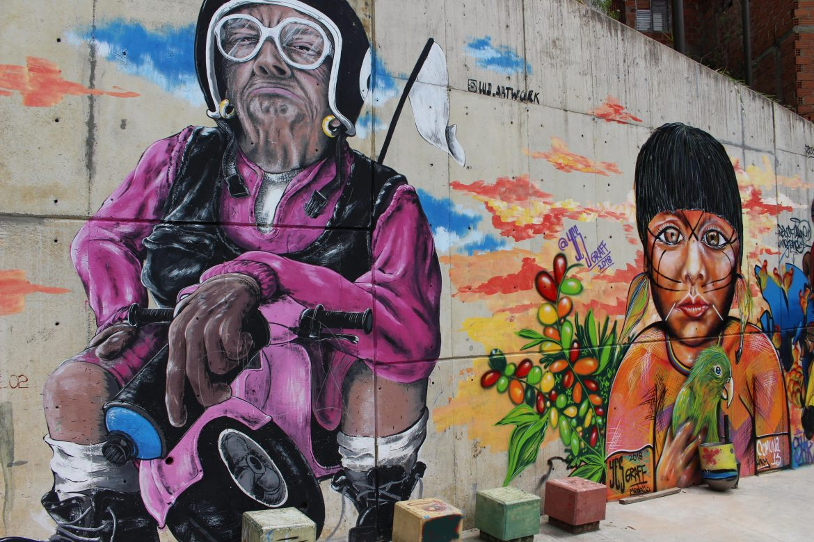 Duo painting street art Medellin